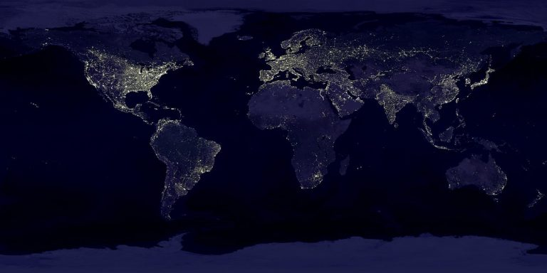 view of the earth from space showing illuminated sections by electricity